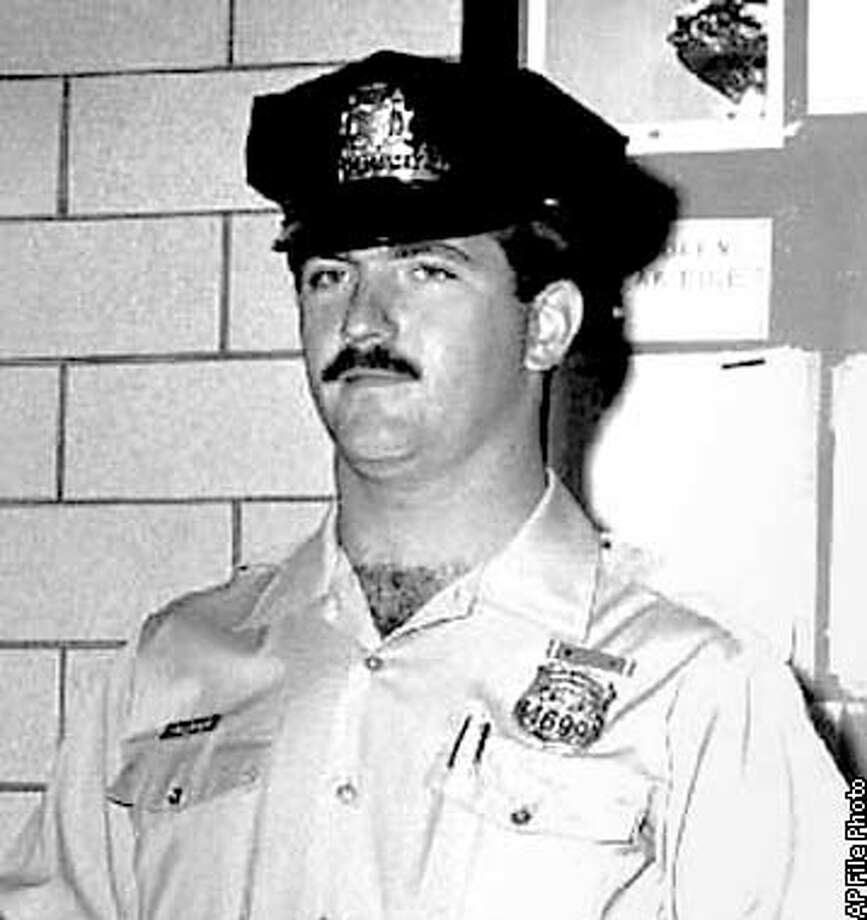 FILE--This is an undated file photo of Philadelphia police officer Daniel Faulkner. A federal judge on Tuesday, Dec. 18, 2001, overturned the death sentence imposed nearly two decades ago on , the former journalist and Black Panther both revered as a crusader against racial injustice and reviled as an unrepentant cop-killer who deserves to die. U.S. District Judge William Yohn cited problems with the jury charge and verdict form in the trial that ended with Abu-Jamal's first-degree murder conviction in the death of Philadelphia police Officer Daniel Faulkner. (AP Photo)