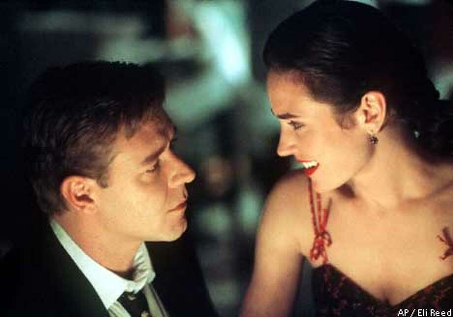 """In """"A Beautiful Mind,"""" Russell Crowe plays math genius John Forbes Nash Jr. and Jennifer Connelly is the woman who loves him. Associated Press photo by Eli Reed"""