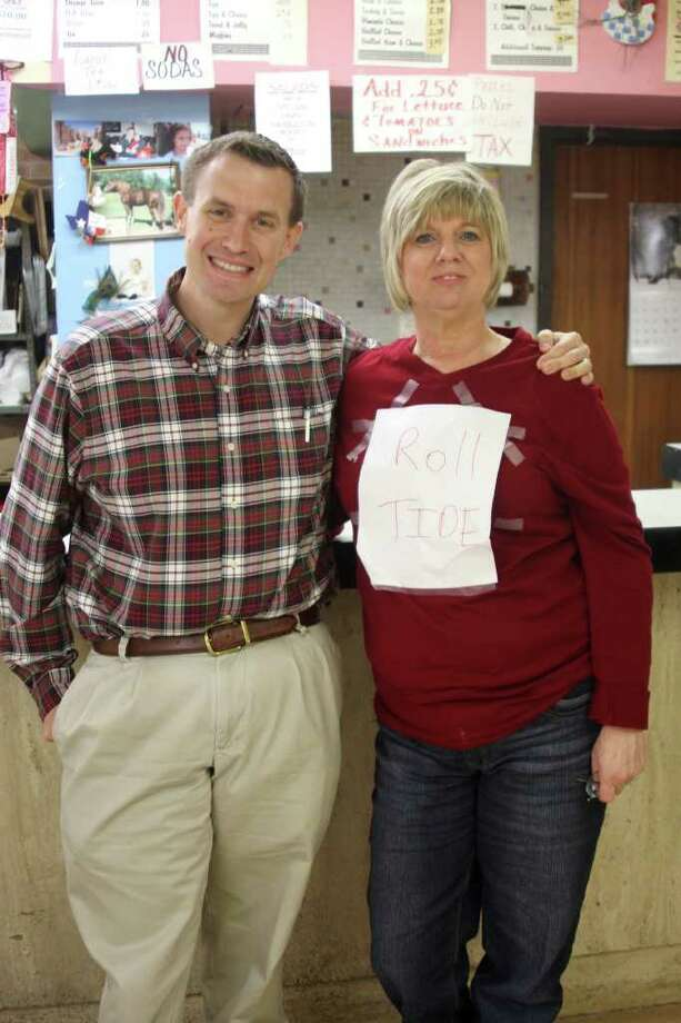County employee Leisa Jones proved to be a good sport after losing a bet to Assistant District Attorney Dallas Barrington. Jones had to wear clothing in support of the Alabama Crimson Tide after they defeated her LSU Tigers for the national championship. Photo: David Lisenby, HCN_Bet