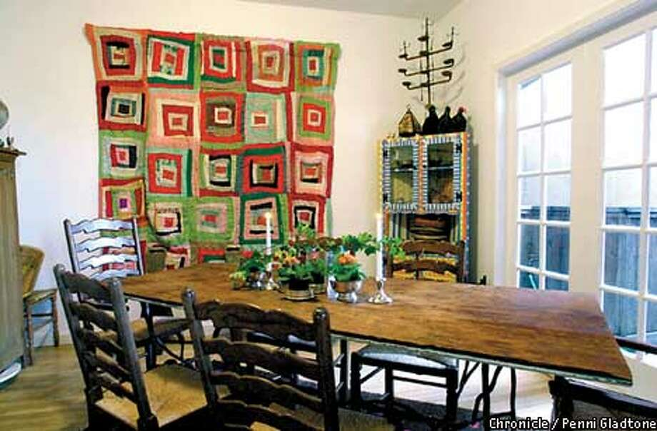 "Ella King Torrey's dining room includes her own cabinet as well as Arester Earl's ""Log Cabin"" quilt and a table by Agnes Bourne. Chronicle photo by Penni Gladstone"