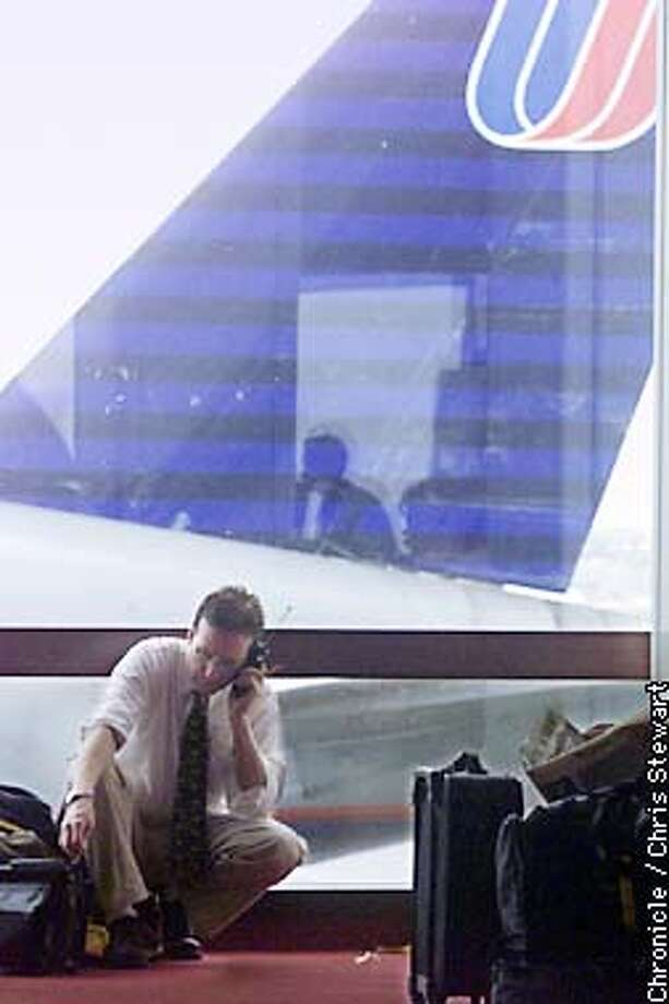A United Airlines shuttle passenger fills downtime making phone calls while waiting for a flight. Shuttle service between SFO and LAX is terrible, with many canceled and postponed flights causing major headaches for business and tourists travelers. SAN FRANCISCO CHRONICLE PHOTO BY CHRIS STEWART Photo: CHRIS STEWART