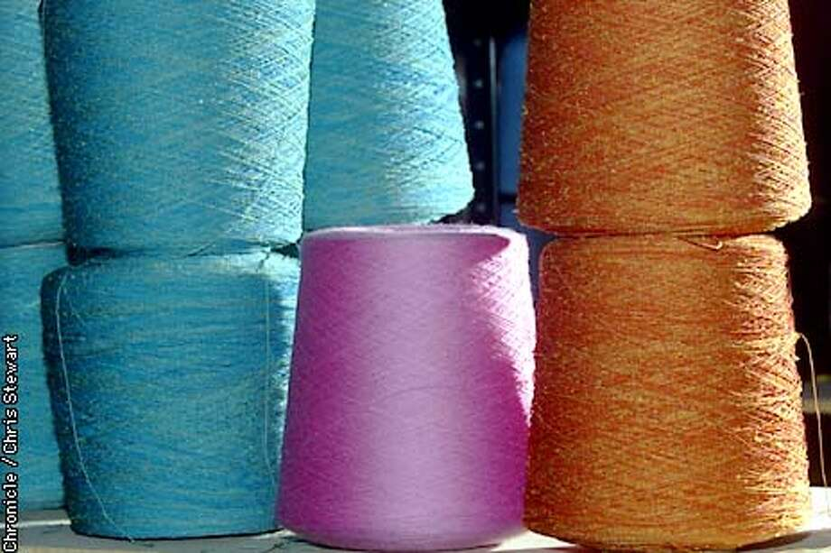 Yarn is stored on shelves where Suzi Johnson designs knitwear in her Natoma Street studio, making handmade sweaters using a loom for her two lines, Souchi blue and Souchi Red. SAN FRANCISCO CHRONICLE PHOTO BY CHRIS STEWART Photo: CHRIS STEWART