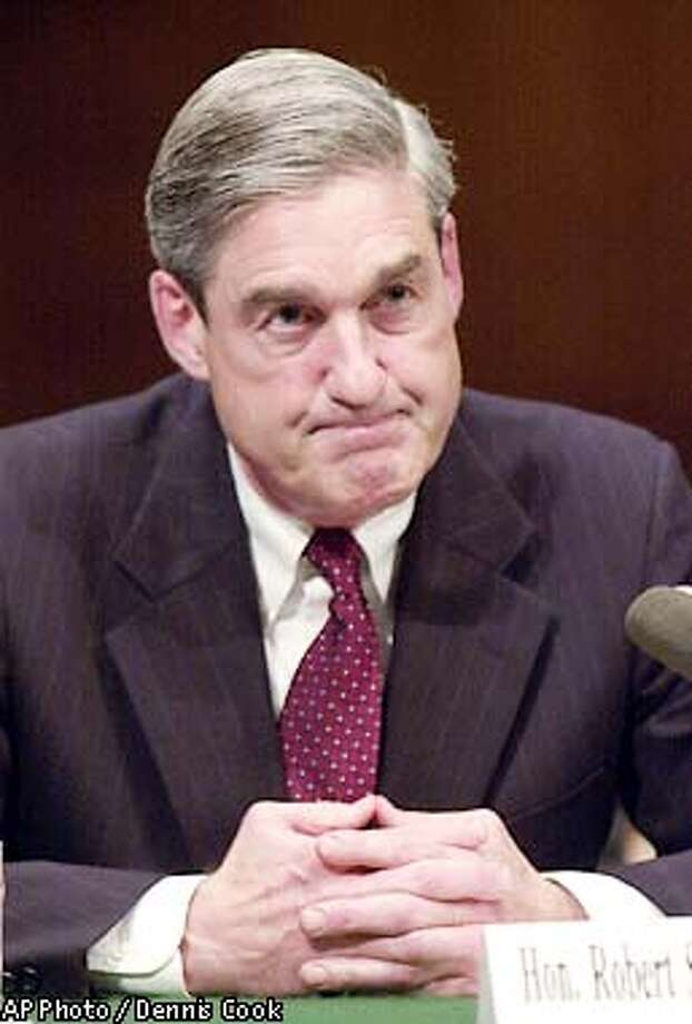 Federal Bureau of Investigation Director Robert Mueller appears before the Senate Judiciary Committee on Capitol Hill Wednesday, May 8, 2002, to discuss reorganizing and refocusing the FBI's mission. (AP Photo/Dennis Cook) Photo: DENNIS COOK