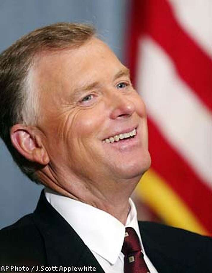 """Former Vice President Dan Quayle smiles during an address at the National Press Club in Washington Thursday, May 9, 2002 where he talked about family policy issues and Hollywood's role in shaping attitudes on the American family. Quayle spoke on the 10th anniversary of his """"Murphy Brown speech,"""" which created a firestorm of debate in 1992. Thursday he commented on """" The Osbournes,"""" an expletive-loaded cable television show on MTV.(AP Photo/J.Scott Applewhite) Photo: J.SCOTT APPLEWHITE"""