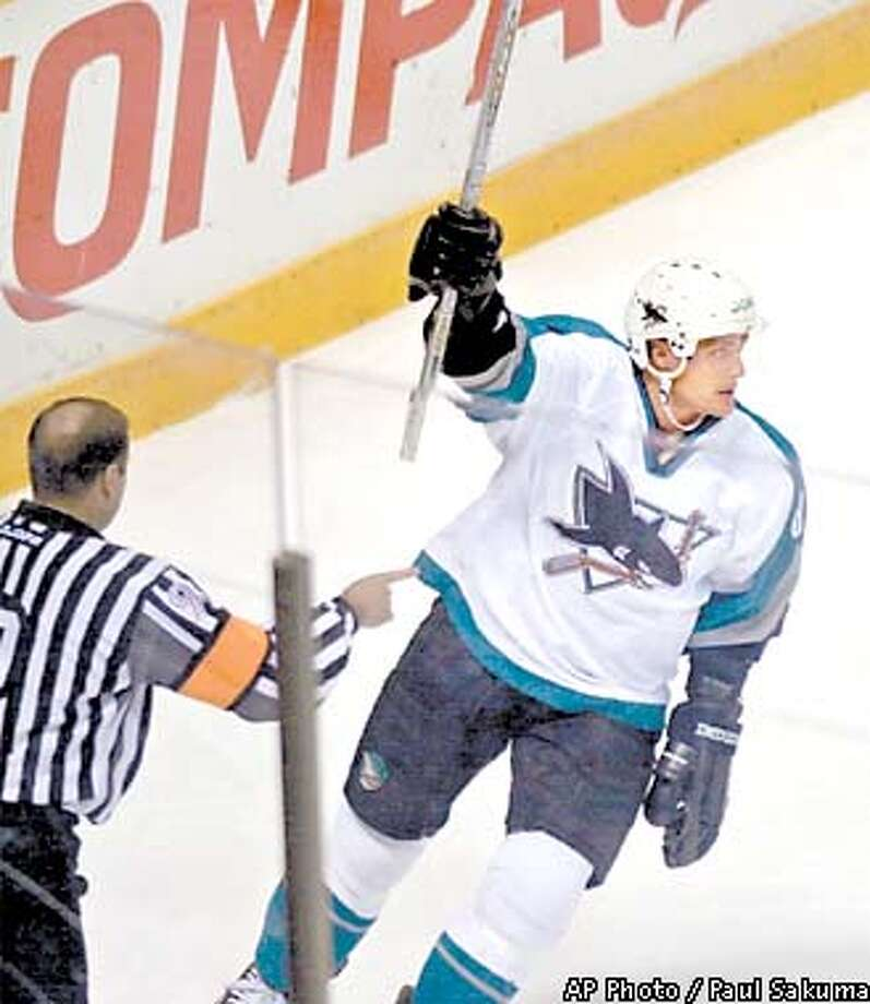 San Jose Sharks right wing Teemu Selanne of Finland holds up his stick after scoring against the Calgary Flames in the first period Tuesday, Dec. 4, 2001, in San Jose, Calif. (AP Photo/Paul Sakuma) Photo: PAUL SAKUMA