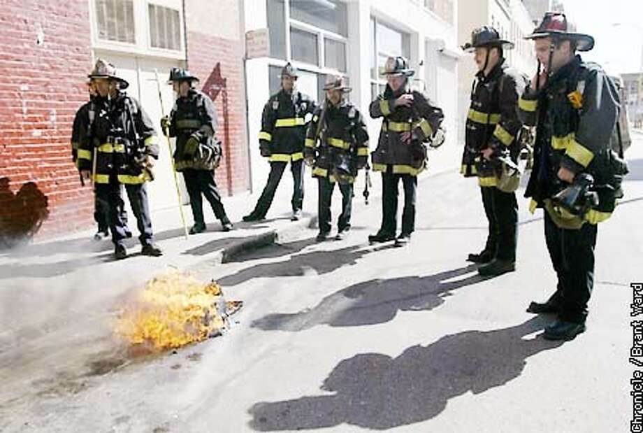 """""""Where are the marshmellows"""" asked one SFFD member as they watched some trash burn near Mary and Mission Streets Tuesday afternoon...the fire evacuated the Chronicle Hotel and caused great traffic congestion in the busy downtown location. By Brant Ward/Chronicle Photo: BRANT WARD"""
