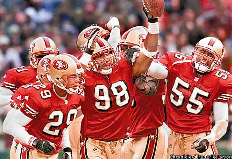San Francisco 49ers vs. Miami Dolphins. Second quarter action. 49ers celebrating, left-right: Ahmed Plummer #29, Julian Peterson #98, and Jamie Winborn #55.  Chronicle Photo by Frederic Larson Photo: FREDERIC LARSON