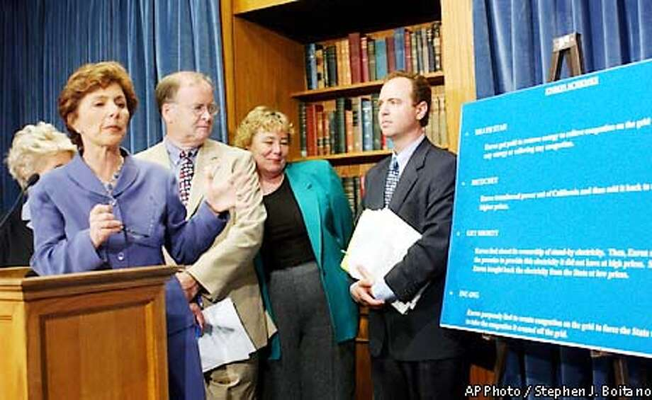 Senator Barbara Boxer, D-Calif, second from left, accompanied by fellow members of Congress, meets reporters on Capitol Hill Thursday, May 9, 2002, in Washington, to call on Congress to investigate the business conduct and pricing practices of the Enron Corp. in California and in other Western states. From left are, Rep. Jane Harman, D-Calif.; Boxer, Rep. Sam Farr, D-Calif.; Rep. Zoe Lofgren, D-Calif.; and Rep. Adam Schiff, D-Calif. (AP Photo/Stephen J. Boitano) Photo: STEPHEN J. BOITANO