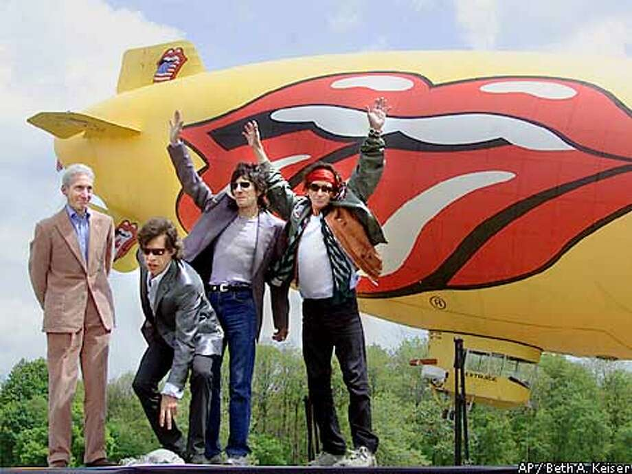 The Rolling Stones arrive at Tuesday's press conference in a blimp. Associated Press photo by Beth A. Keiser