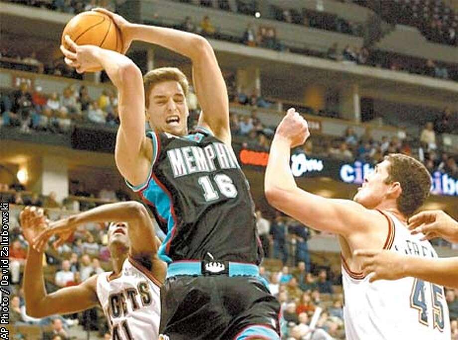 Memphis Grizzlies forward Pau Gasol (16) of Spain pulls down a rebound in front of Denver Nuggets forward James Posey, left, and center Raef LaFrentz in the first quarter in Denver on Thursday, Dec. 13, 2001. (AP Photo/David Zalubowski) Photo: DAVID ZALUBOWSKI
