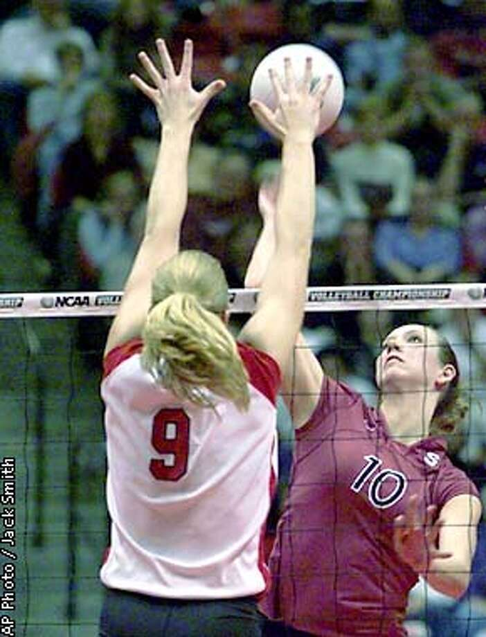 Nebraska's Laura Pilakowski (9) blocks a shot by Stanford's Tara Conrad (10) during first game of their NCAA championship semifinal match Thursday night, Dec. 13, 2001, in San Diego. (AP Photo/Jack Smith) Photo: JACK SMITH