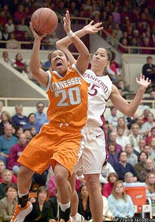Tennessee guard Kara Lawson, foreground, drives past Stanford guard Lindsey Yamasaki for a shot during the first half Sunday, Dec. 16, 2001, in Stanford, Calif. (AP Photo/Julie Jacobson) Photo: JULIE JACOBSON