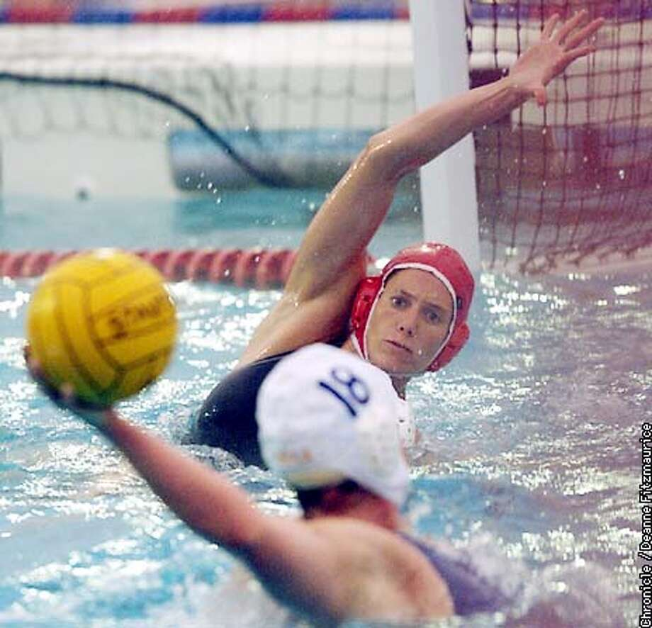 Ellen Estes from Novato, California is a leader on Stanford's number one waterpolo team. She is blocking a shot by Robin Beauregard in game against UCLA Bruins at Stanford.  CHRONICLE PHOTO BY DEANNE FITZMAURICE Photo: DEANNE FITZMAURICE