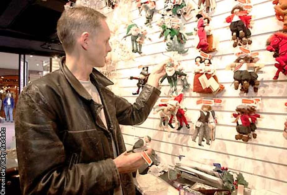 Photo by Katy Raddatz--The chronicle  Helper Home Bazaar is a gift shop in Ghirardelli Square, open all year, that benefits Helpers of the Mentally Retarded. SHOWN: Alistair Shanks of SF buys toy elves for his nieces and nephews in Canada. Photo: KATY RADDATZ