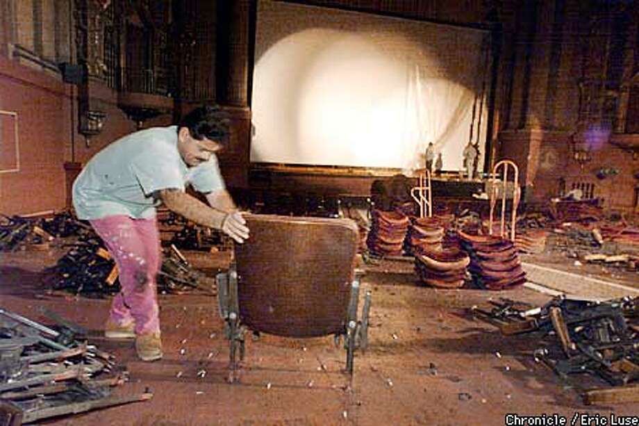 Rafael Maraquis strugles with a well bolted seat that does not want to come out. The Castro Theater is undergoing renovation which includes new seats. BY ERIC LUSE/THE CHRONICLE Photo: ERIC LUSE