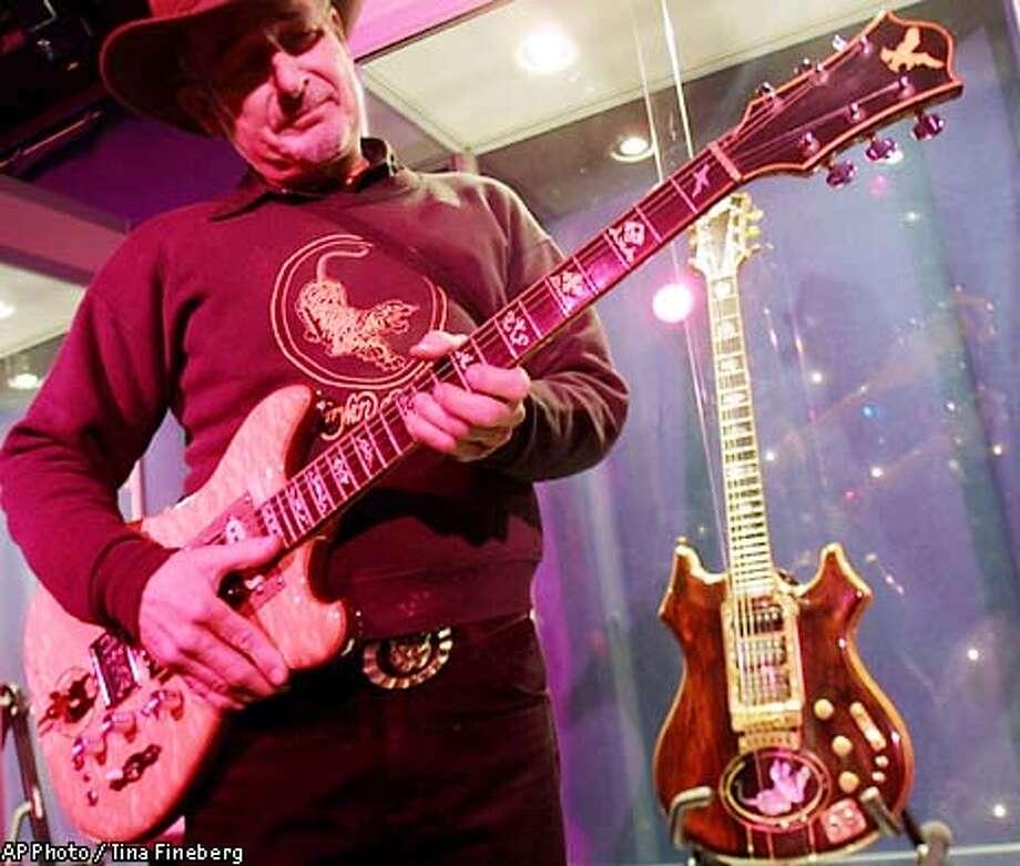 Garcias Guitars Fetch Record Wolf Tiger Sold At Memorabilia