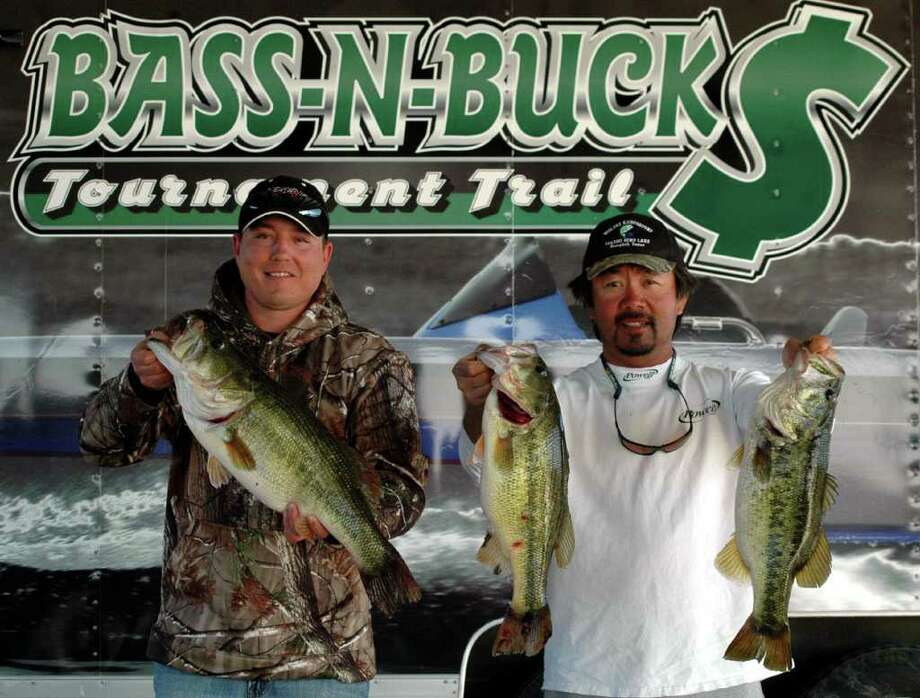 Brandon Davidson holds the Big Bass of the tournament weighing 8.58 lbs, and Ben Matsubu holds two more of their limit that won 1st place overall totaling 26.24 lbs  Photo by Patty Lenderman / Lakecaster