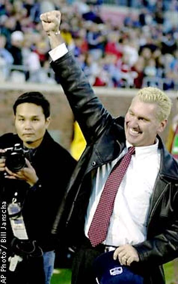 Santa Clara coach Jerry Smith, right, celebrates his team's 1-0 win over North Carolina at the NCAA Women's Soccer College Cup championship game in Dallas, Sunday, Dec. 9, 2001. (AP Photo/Bill Janscha) Photo: BILL JANSCHA