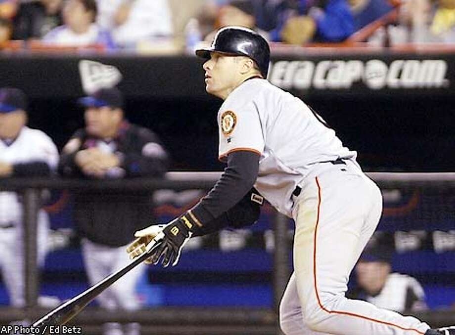 San Francisco Giants' J T Snow watches the ball after hitting an RBI single to score Jeff Kent against the New York Mets during the fifth inning at Shea Stadium in New York, Wednesday, May 8, 2002, (AP Photo/Ed Betz) Photo: ED BETZ