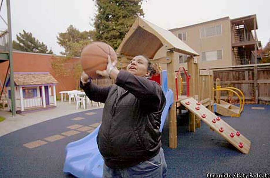 Photo by Katy Raddatz--The Chronicle  Berkeley Emergency Food and Housing Project. SHOWN: Loretta Enriquez plays basketball in the play yard of the women's shelter on Dwight Way in Berkeley. The structures and tiny playhouse were donated to the shelter. Vicky Elliott is the reporter. Photo: KATY RADDATZ