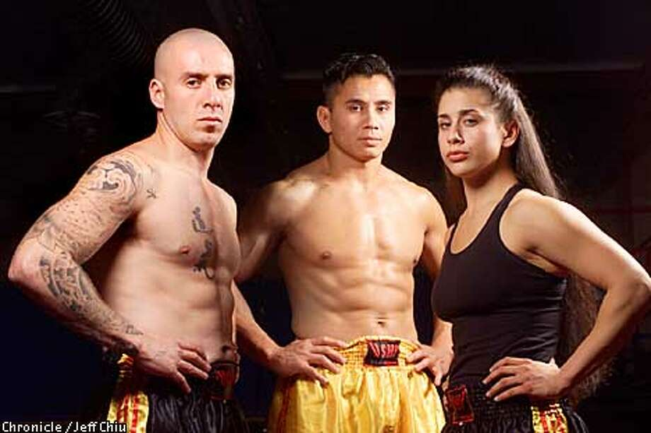 From left: Sanshou kickboxing champions Rudi Ott, Cung Le, and Jenna Castillo will be fighting at the United for the Children charity program at the San Jose Event Center on December 15. Ott will be defending his intercontinental middleweight title against Peter Kaljevic, Le will defend his light heavyweight world title against Shonie Carter, and Castillo will defend her national amatuer lightweight title against Christine Yandolli. Photo by Jeff Chiu / The Chronicle. Photo: Jeff Chiu