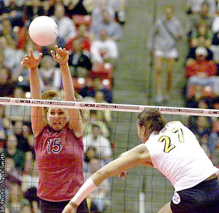 Stanford's Logna Tom (15) gets the block as Long Beach State's Cheryl Weaver (27) tries to score during the NCAA women's Division I volleyball championship match Saturday, Dec. 15, 2001, in San Diego. (AP Photo/Jack Smith) Photo: JACK SMITH