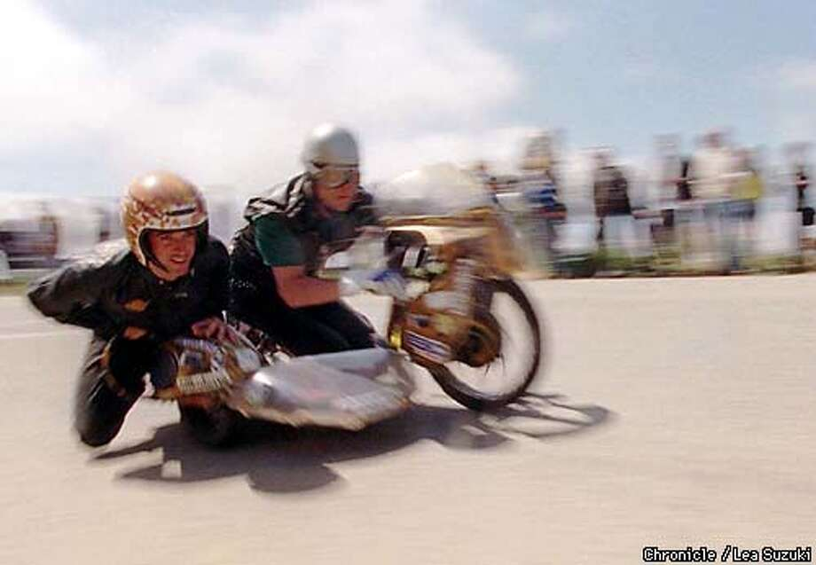 "Kory O'Conner drives ""Dodgy"" John Bass down the hill in the Subculture Sidecar during the San Francisco Illegal Soapbox Society Races on Bernal Heights in San Francisco Sunday, May 11, 1997. (AP Photo/San Francisco Chronicle, Lea Suzuki) Photo: LEA SUZUKI"