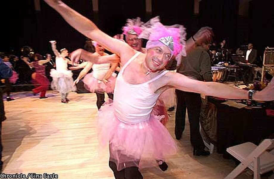Ric Duran leads the Buttcrackers, a group of friends from Vallejo who came dressed in pink tutus, around the dance floor at this year's Dance-Along Nutcracker at the Yerba Buena Arts Center. Photo by Gina Gayle/The SF Chronicle. Photo: GINA GAYLE