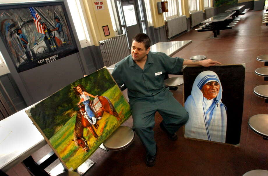 In this Oct. 29, 3003, Vincent Harris sits in the cafeteria with with some of his paintings at the Mt. McGregor Correctional Facility in Wilton, N.Y. Harris, who served decades for killing a man,  was charged in Rensselaer County for an alleged burglary.  (CINDY SCHULTZ / TIMES UNION archive)