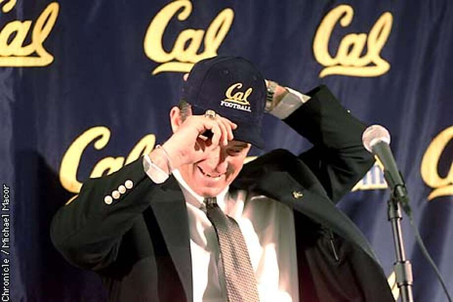 Jeff Tedford of Oregon named the new Head Football Coach today at UC Berkeley. Tedford puts on a Cal cap as he meets the press. Press conference held to make the announement. by Michael MAcor/The Chronicle Photo: MICHAEL MACOR