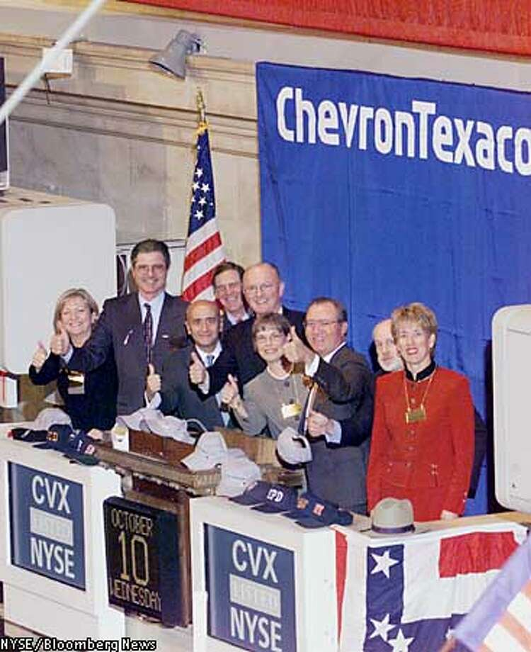 The New York Stock Exchange welcomes executives from Chevron and Texaco to ring the opening bell, October 10, 2001, in New York City, New York to celebrate the companies' merger. (left to right) Rosemary Moore,Vice President,Public Affairs,Texaco,Inc; Harvey Hinman, Vice President &General Counsel, Chevron Corp.; John Watson, Vice President & CFO, Chevron Corp. , Richard Grasso, Chairman & CEO, NYSE; David O'Reilly, Chairman of the Board & CEO, Chevron Corp, Glenn Tilton, Vice Chairman of the Board, Texaco, Inc.; Joan O'Reilly,spouse of Dave O'Reilly, William R. Johnston, President & COO, NYSE, and Lydia Beebe, Corporate Secretary, Chevron Corp. Source: NYSE/ via Bloomberg News.