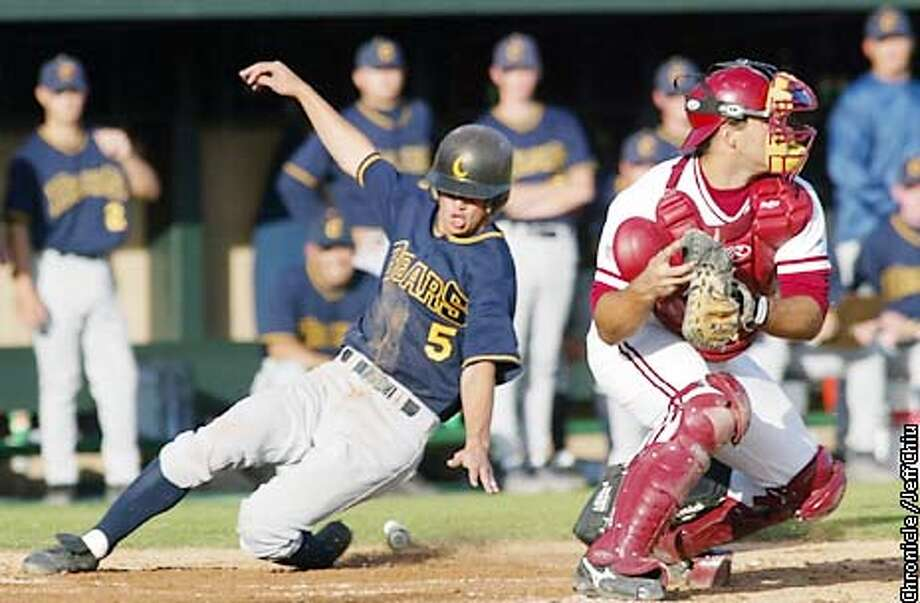 Cal's David Nicholson slides in safe at home in the second inning off of teammate Brian Horwitz's triple past Stanford catcer Ryan Garko as the Stanford Cardinal host the Cal Bears on Friday evening at Stanford. Photo by Jeff Chiu / The Chronicle. Photo: Jeff Chiu