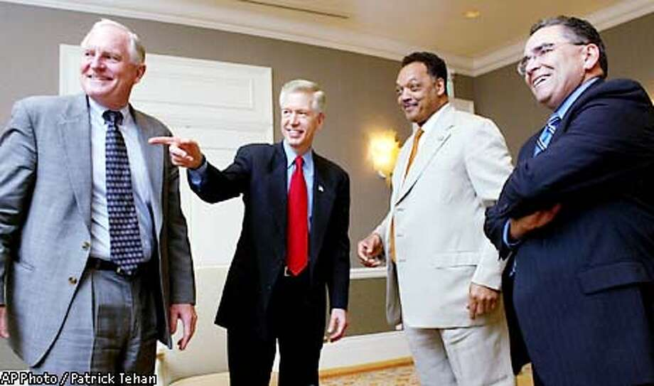 """Craig Barrett, CEO of Intel, left, California Governor Gray Davis, the Rev. Jesse Jackson, and San Jose Mayor Ron Gonzales share a laugh prior to a luncheon at the Fairmont Hotel in downtown San Jose, Calif. Wednesday afternoon, April 24, 2002. The luncheon was part of """"Governor's California Roundtable: Small Business Opportunities in the New Economy"""" (AP Photo/San Jose Mercury News, Patrick Tehan) Photo: PATRICK TEHAN"""