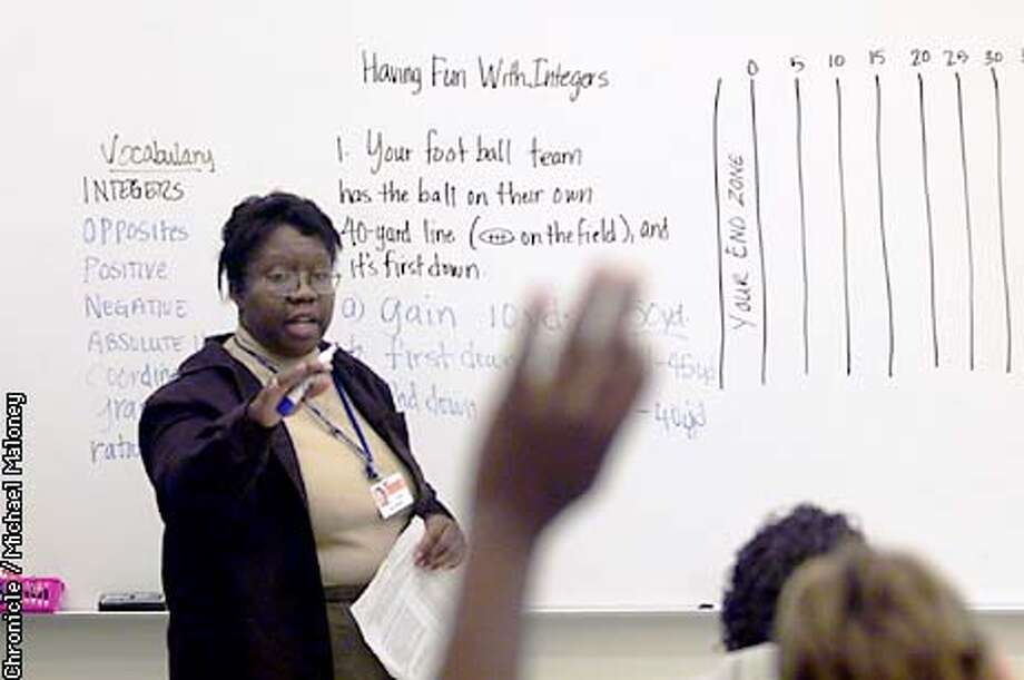 """Pittsburg's Hillview Junior High teacher Donna Bussey uses a football field to help her 8th graders understand the concepts behind finding """"absolute value"""".  California algebra teachers and their students face many challenges now that all high school students must pass algebra to graduate. Pressure is now on middle schools to prepare their kids to understand algebra in the 9th grade.  CHRONICLE PHOTO BY MICHAEL MALONEY Photo: MICHAEL MALONEY"""