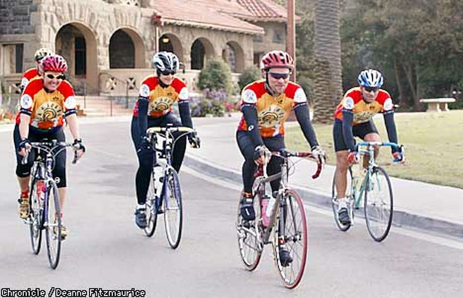Bike riders, (l to r) Cathy Johnson, Russ Olevsky, Eric Rozendahl, and Deyon Jonson (cq) leave the meeting site, McLaren Lodge in Golden Gate Park in San Francisco as the group rides to Guerneville as part of their training for a ride that is competing with the controversial California AIDS ride. CHRONICLE PHOTO BY DEANNE FITZMAURICE Photo: DEANNE FITZMAURICE