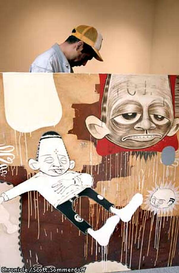 Artist Barry McGee shown with one of his older works that he plans to rework for display in this upcoming gallery show. NOTE: He wants to maintain his anonymity - thus the silohette. (SF CHRONICLE PHOTO BY SCOTT SOMMERDORF) Photo: SCOTT SOMMERDORF