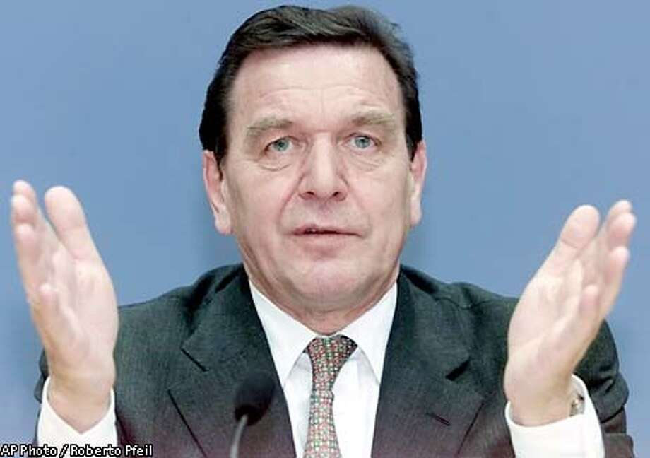 German Chancellor Gerhard Schroeder gestures during a news conference in Berlin Tuesday, Nov. 6, 2001, where he offered up to 3,900 German troops for the U.S. war on terrorism, backing up Germany's pledge of solidarity with the United States. (AP Photo/Roberto Pfeil) Photo: ROBERTO PFEIL