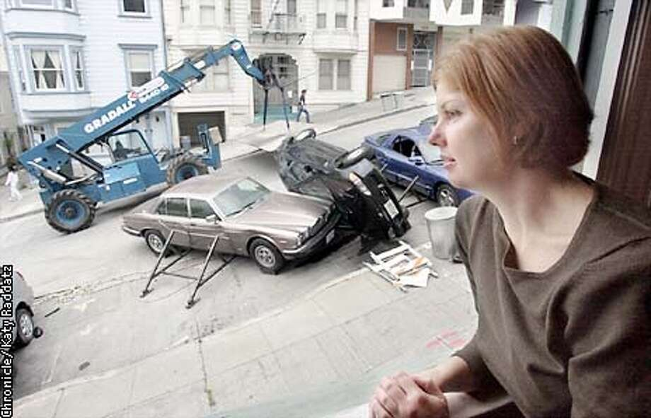 """PHOTO BY KATY RADDATZ--THE CHRONICLE  Movie called """"The Hulk"""" is filming sequences on Vallejo St. Telegraph Hill dwellers are nervous, some upset, some curious about the action. SHOWN: Sharon Foote, lives on Vallejo St. watches cleanup action of car crashes. Photo: KATY RADDATZ"""