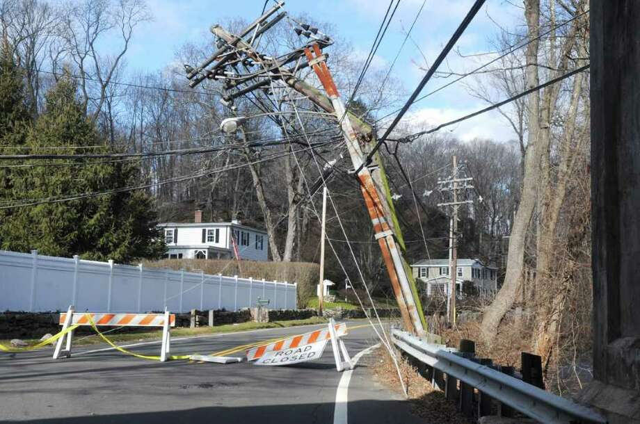 Police closed Riversville Road between Sherwood Avenue and Porchuck Road Monday morning after a truck ran into low hanging lines and badly damaged a utility pole, causing a power outage to 91 Connecticut Light & Power customers. There were no injuries in the incident. Photo: Helen Neafsey / Greenwich Time