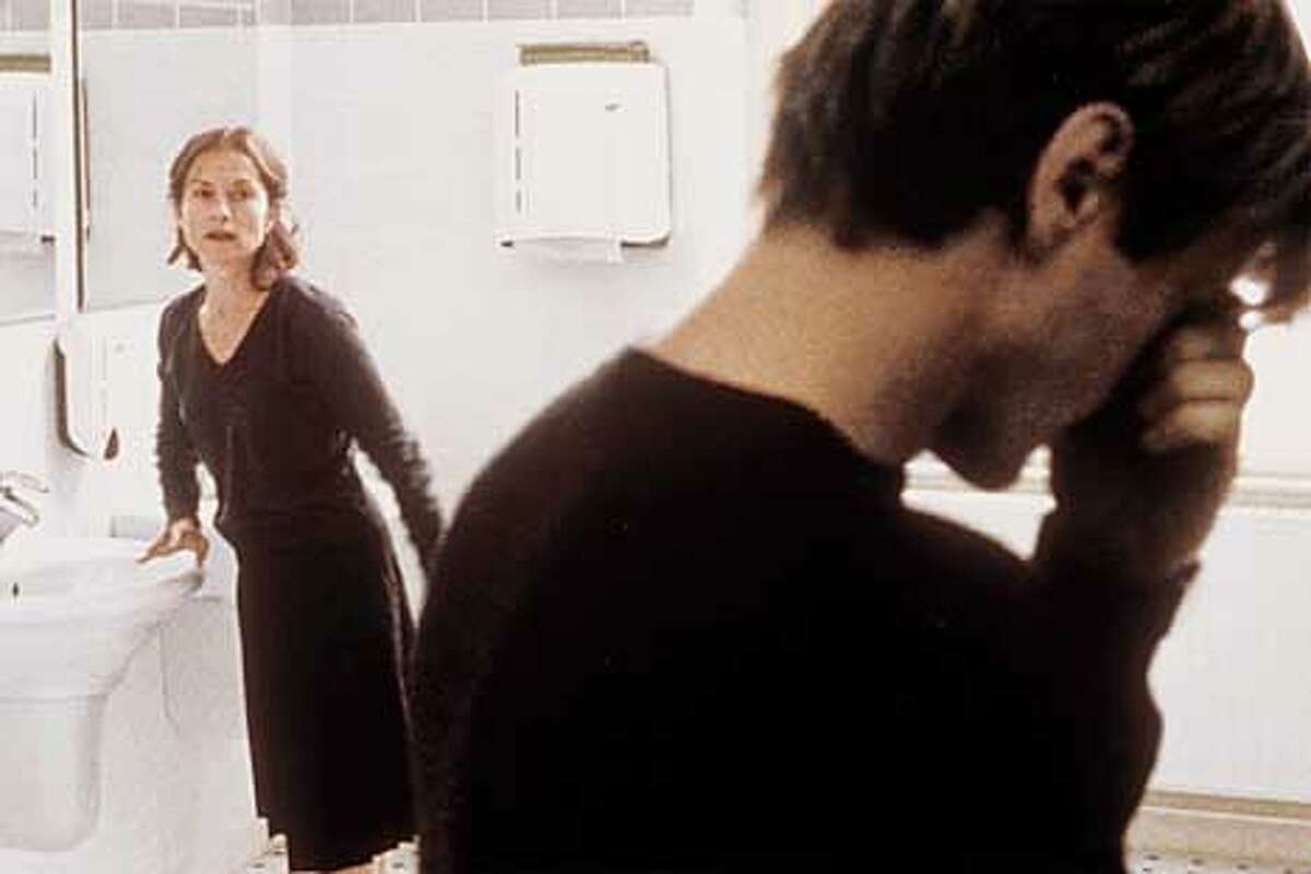 Isabelle Huppert and Benoit Magimel in THE PEIANO TEACHER