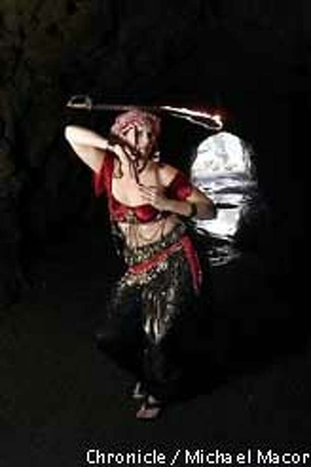 """Eveline Darroch belly dances with a flaming sword balanced on her head: """"You're creating people's realities, expanding the boundaries of what they've experienced,"""" says the 30-year-old ex-Marine."""