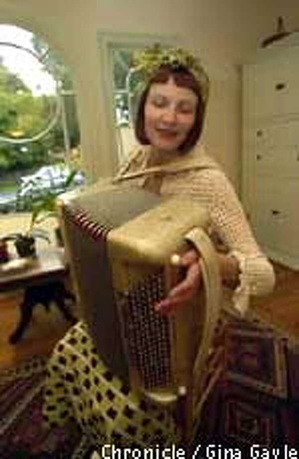 """Odile Lavault: """"The sound just made me cry. I dropped everything for the accordion.'' Chronicle photo by Gina Gayle"""