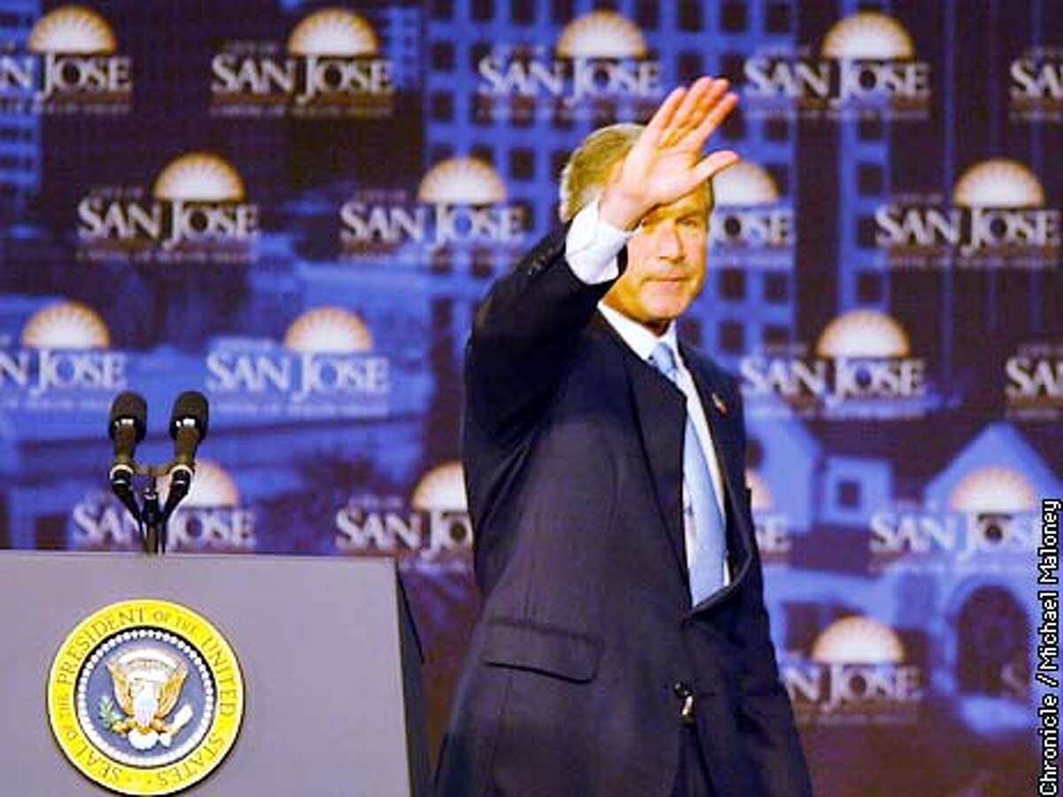 President George W. Bush waves after his speech to members and guests of the Commonwealth Club in Parkside Hall in downtown San Jose. CHRONICLE PHOTO BY MICHAEL MALONEY