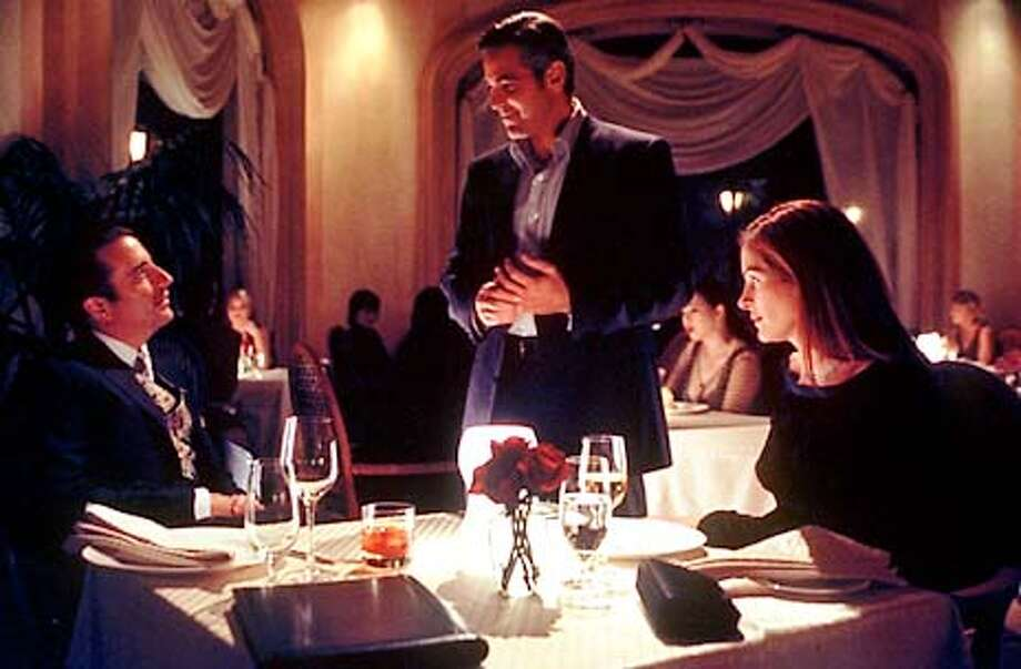 Danny Ocean (George Clooney, center), the brains behind a mammoth Las Vegas heist, encounters the billionaire casino owner (Andy Garcia) who is courting his ex-wife (Julia Roberts). Photo: HANDOUT