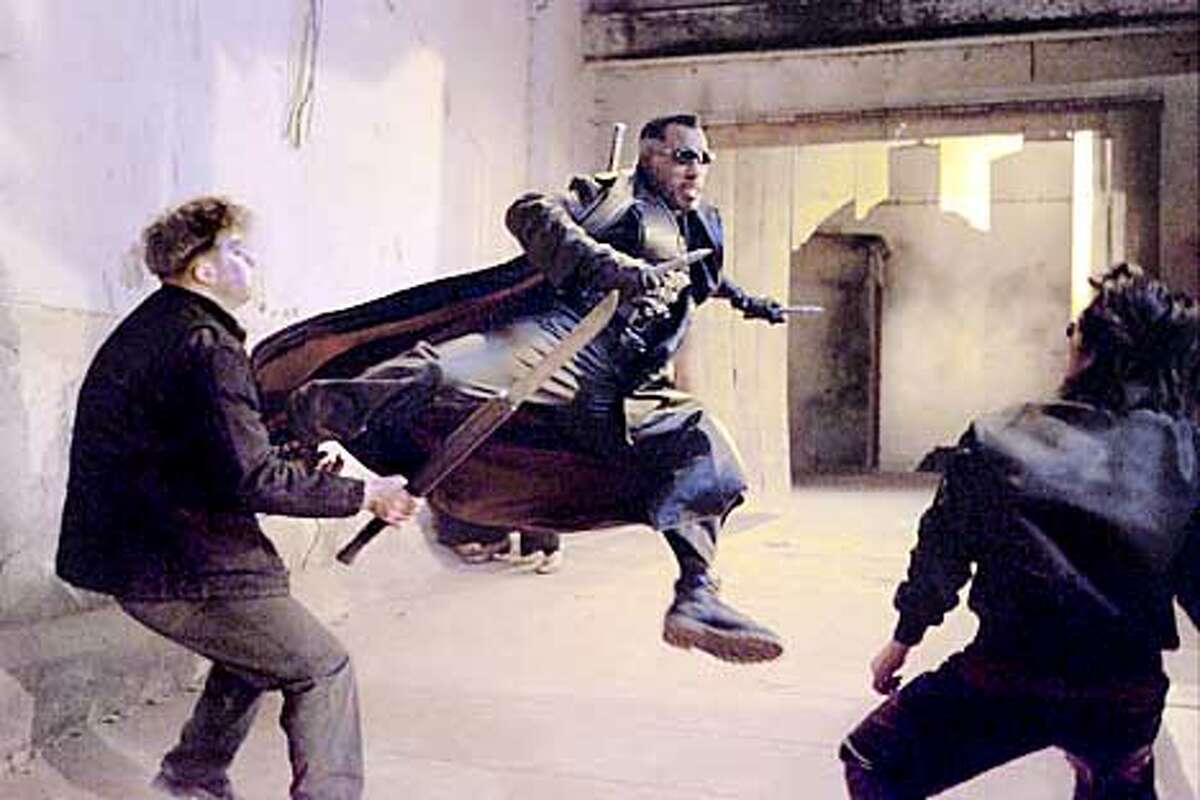 Cn104-3a Blade (Wesley Snipes, center) takes care of some Vampires in New Line Cinema�s action thriller, BLADE II. Photo: Bruce Talamon/New Line Cinema (HANDOUT PHOTO)