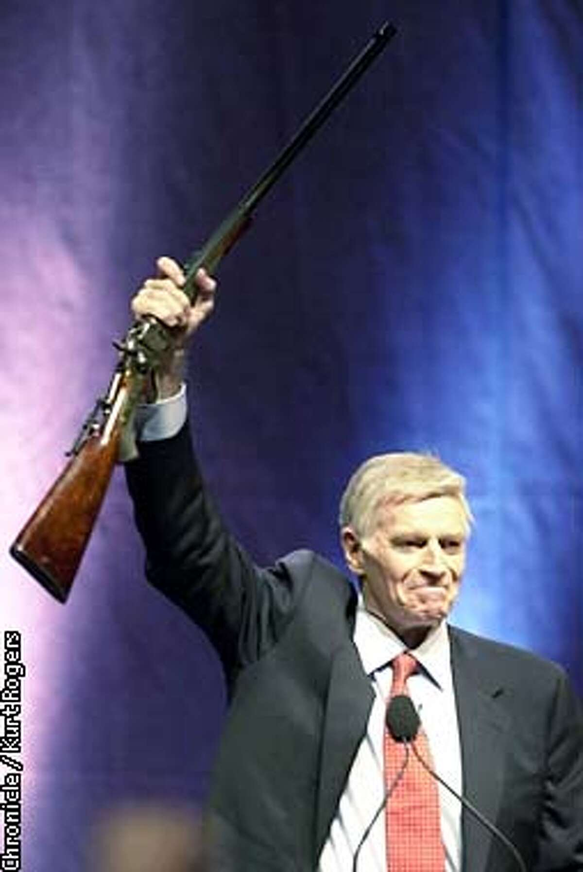 Charlton Heston the president of the NRA addresses the members that were attending and held up a rifle he was given. 131st Annual National Rifle Association Meeting at the Reno Convention Center .Photo By Kurt Rogers
