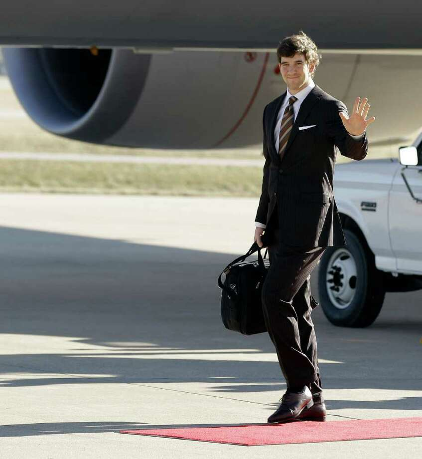 New York Giants quarterback Eli Manning waves as the team arrives at the Indianapolis International Airport for NFL footbal's Super Bowl XLVI Monday, Jan. 30, 2012, in Indianapolis. (AP Photo/Morry Gash) Photo: Morry Gash