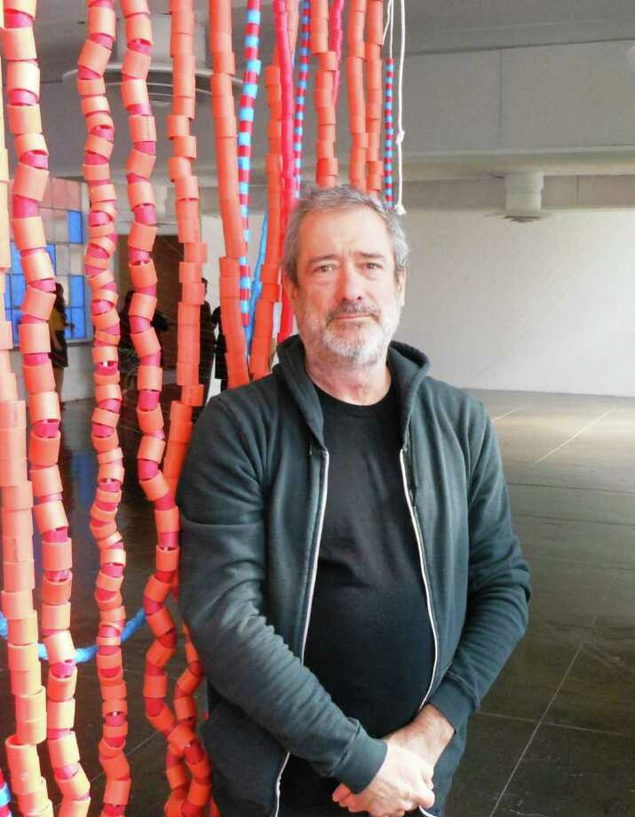 Artist Tony Feher takes inspiration from a space's architectural elements in making installations that often include construction materials such as plastic tubing, construction twine and tape. Photo: Steve Bennett, San Antonio Express-Newss