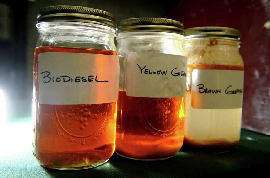 A sample of biodiesel on display with samples of the yellow and brown grease from which is rendered. Photo: Ned Gerard / Connecticut Post