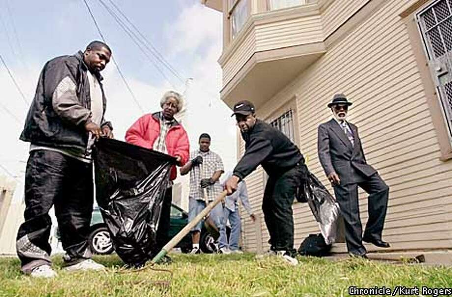 Arelious Walker, on the right pastor of TheTrue Hope Churc of God and Christ, Bayview, had men from the drug rehanb center he supervises mowing the lawn of a new seniorcenter that is opening.Photo By Kurt Rogers Photo: Kurt Rogers